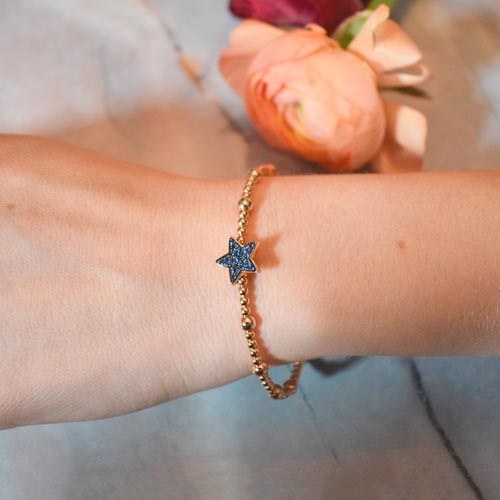 HBC brazalete estrella oro rosado y zafiros