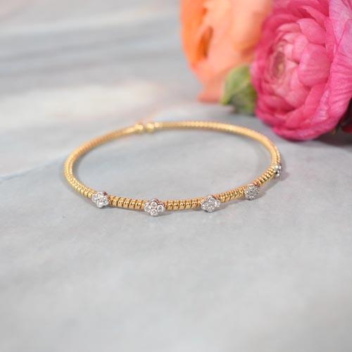 HBC Brazalete Flores oro y diamantes
